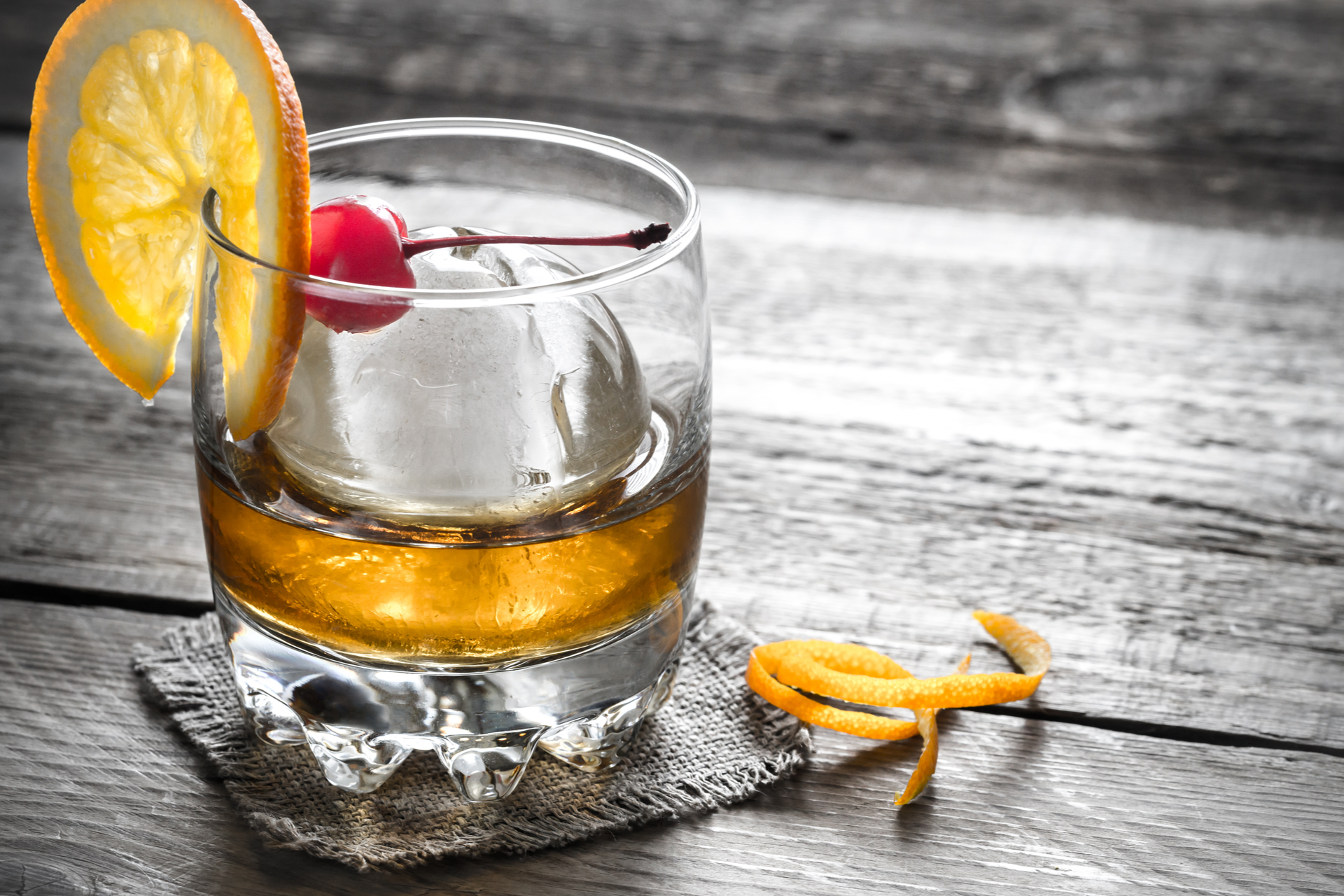 Old Fashioned Cocktails with a sphere ice cube
